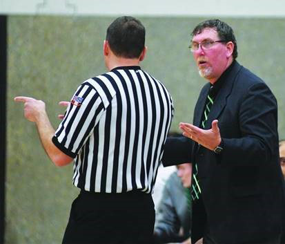 Joel Wisz talks to Rock Falls coach Brad Bickett during a regional semi-final game